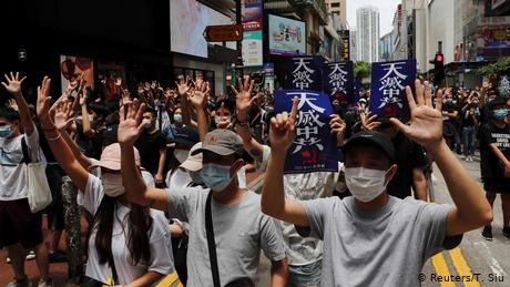 Hong Kong: Tear gas fired as thousands protest against new security law