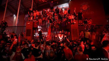 Liverpool fans celebrate Premier League victory