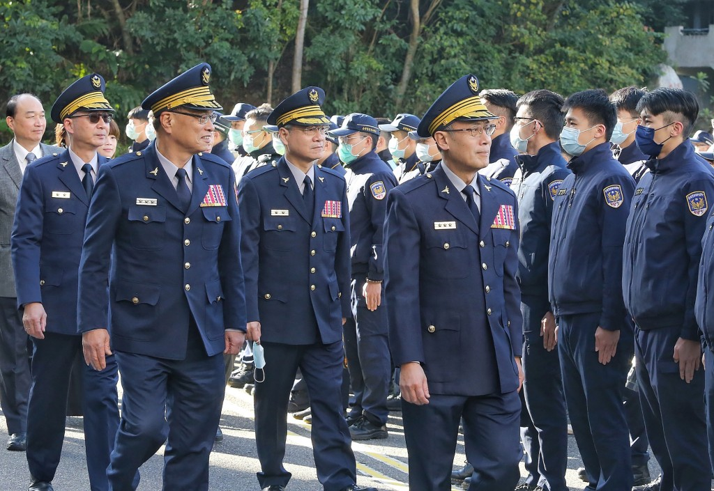 Police officers at an official event Wednesday