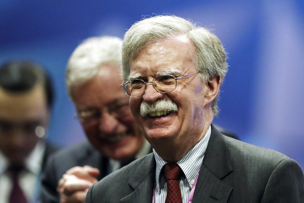 Former U.S. National Security Adviser John Bolton (right)