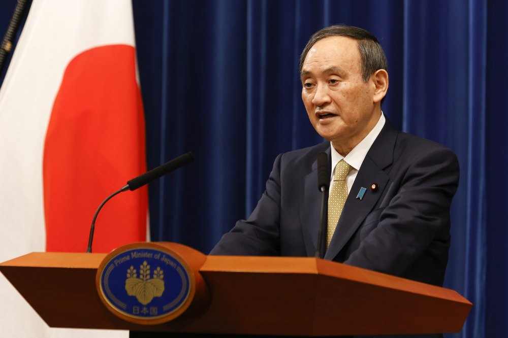 Japanese Prime Minister Suga Yoshihide announcing new coronavirus prevention measures Wednesday