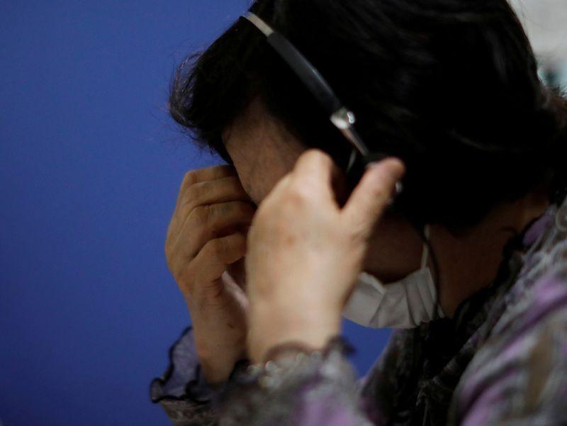 不只是自殺率升高,日本目前的疫情狀況並不樂觀。(圖/路透社)