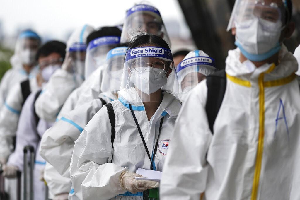 Passengers wearing protective suits at Manila's Ninoy Aquino International Airport on Jan. 18.