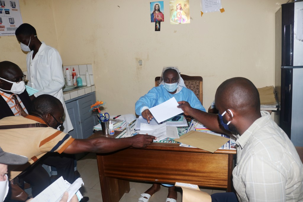 Stock imageshows manhandpositiveCOVID-19test result to Saint Paul Catholic Hospital deputy director in Douala,Came...