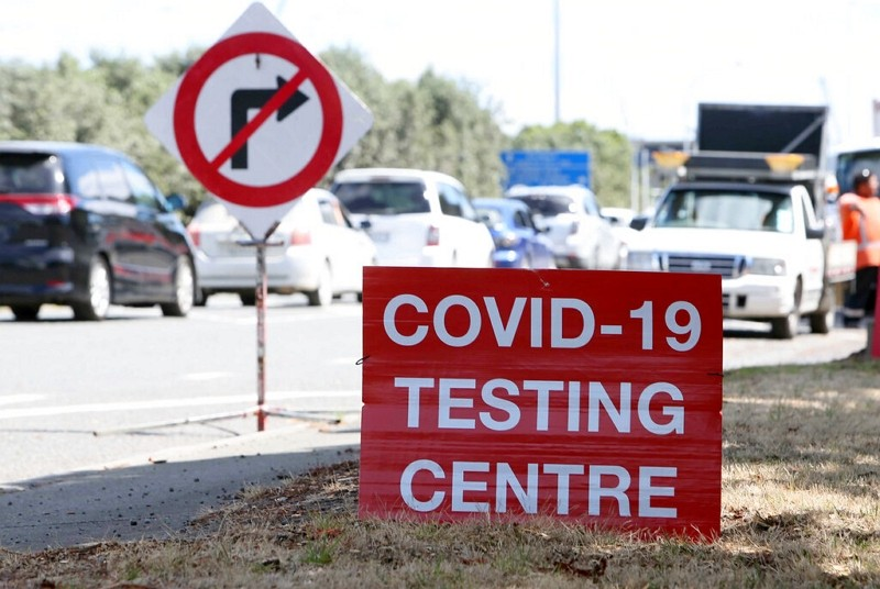 Signs direct drivers waiting for a COVID-19 testing at a pop-up testing center at Marsden Point, New Zealand.