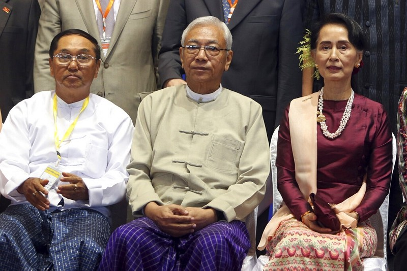 In this Oct. 15, 2017, file photo, Myanmar's Vice President Myint Swe, left, sits with State Counsellor Aung San Suu Kyi, right, and then Presiden...