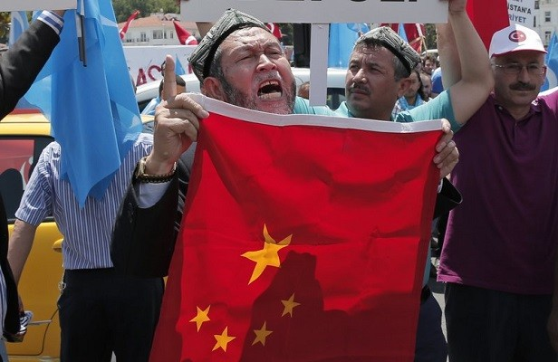 Uighurs and supporters in Turkey protest near China's consulate in Istanbul July 5, 2015.