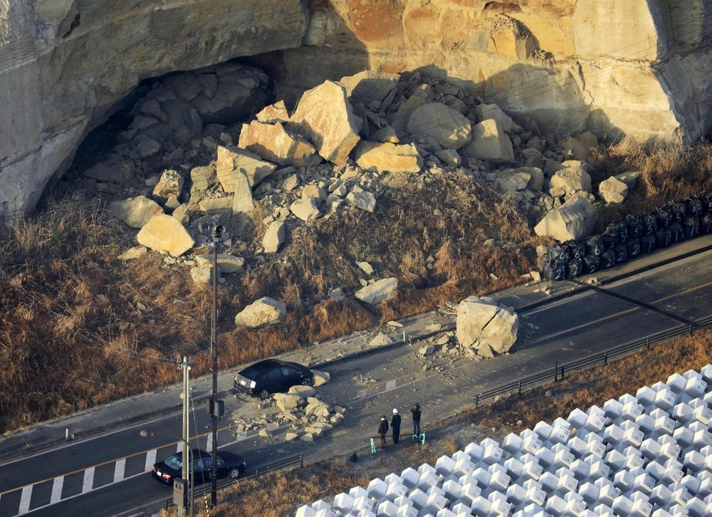 A large boulder sits on a road after an earthquake hit the city, in Soma, Fukushima prefecture, northeastern Japan.