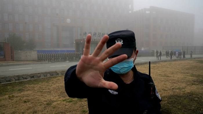 Security guard blocks journalists from the Wuhan Institute of Virology during a visit by World Health Organization investigators.