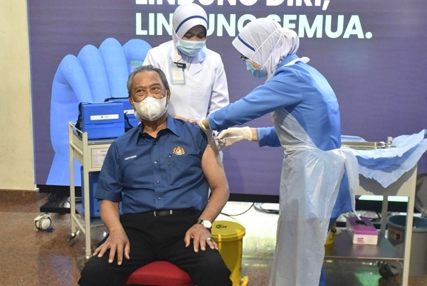 Malaysia's Prime Minister Muhyiddin Yassin received COVID-19 vaccine shot on Wednesday at the start of the inoculation campaign. (Malaysia Health ...