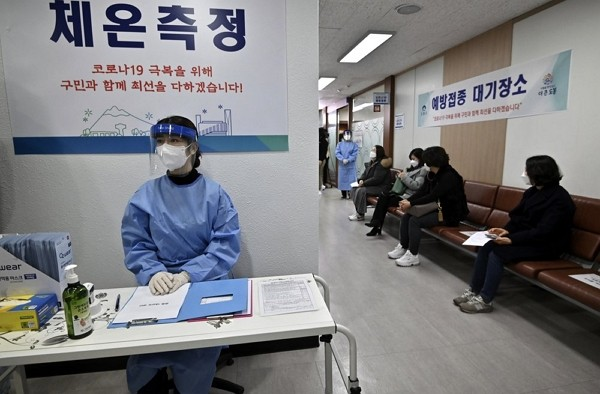 Nursing home workers, sitting at right, wait to receivefirst dose ofAstraZeneca COVID-19 vaccine at health care center in Seoul.
