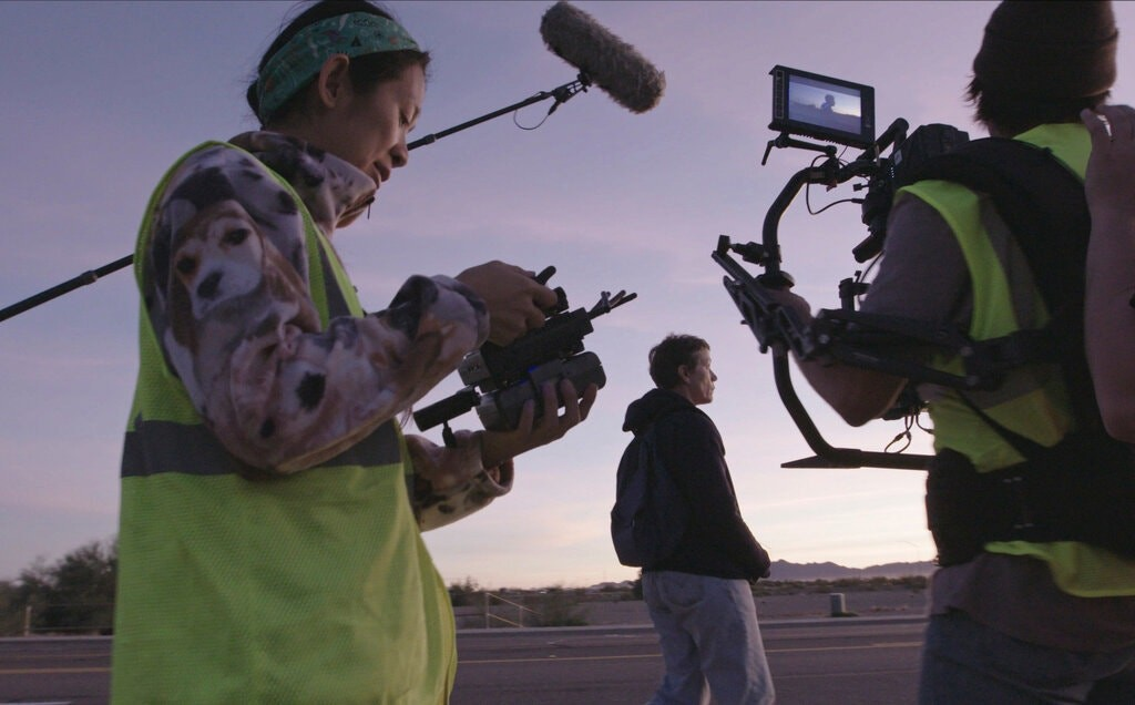 Director Chloe Zhao (left) on the set of Nomadland (AP photo, Searchlight Pictures)