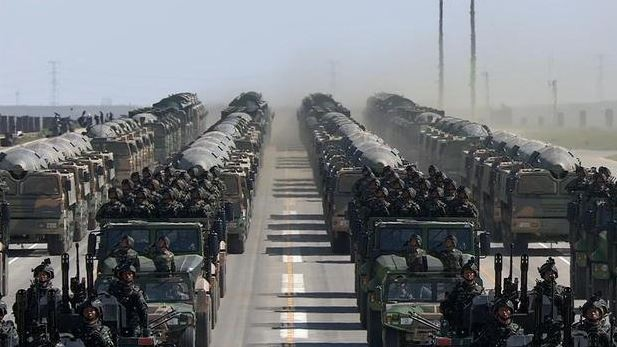 PLA soldiers and missile vehicles. (Weibo image)