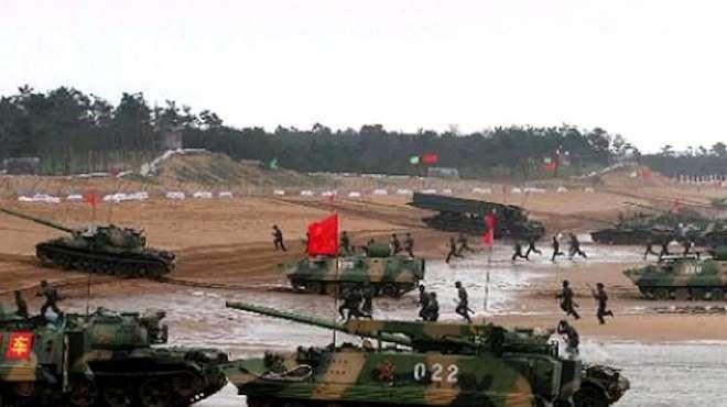 PLA troops practice amphibious landing.(PLA Eastern Theater Command photo)