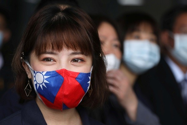 Woman wearing face mask with Taiwan flag pattern. (Reuters photo)