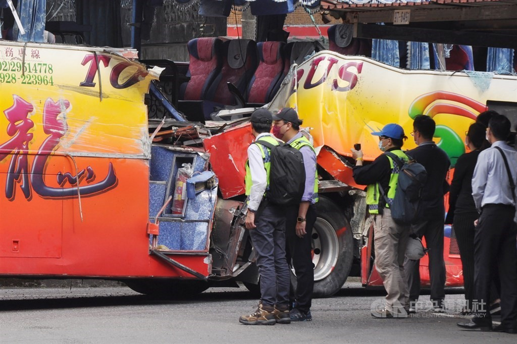 Inspectors taking a look at the bus involved in the deadly March 16 crash