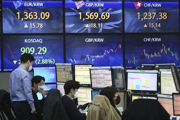 Currency traders watches monitors at the foreign exchange dealing room of the KEB Hana Bank headquarters in Seoul, South Korea.