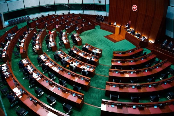 China's top legislature approved amendments to Hong Kong's constitution on Tuesday to give Beijing more control over the make-up of the city&#...