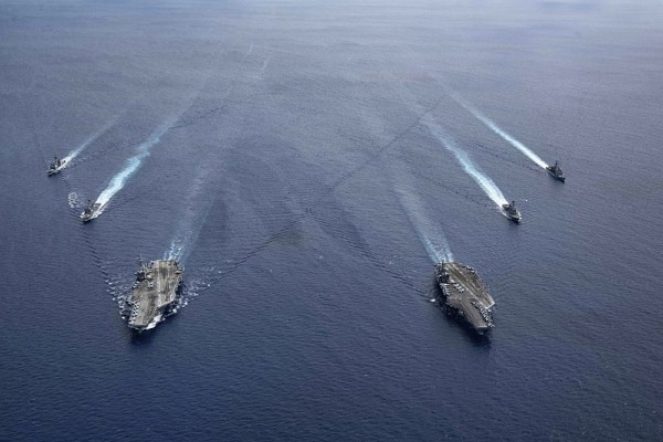 In this photo provided by U.S. Navy, the USS Ronald Reagan (CVN 76) and USS Nimitz (CVN 68) Carrier Strike Groups steam in formation, in the South Chi...