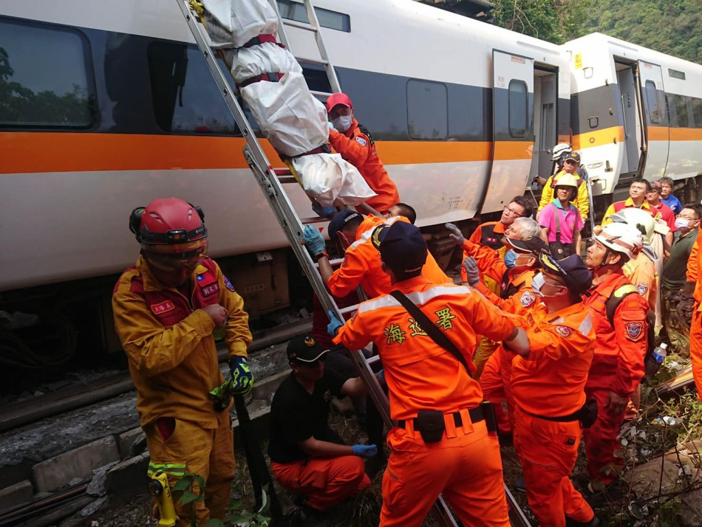 Coast Guard officers lower an unidentified body of a victim of the train derailment. (Facebook, CGA.east photo)