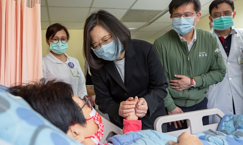 Taiwanese President Tsai Ing-wen visits those injured in Friday's train derailment at a hospital in Hualien on April 3, 2021. (Presidential Office...