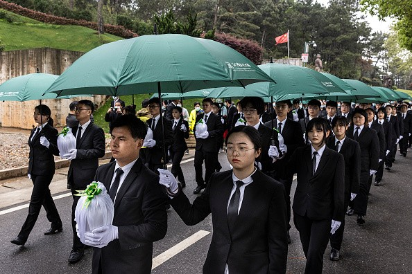 Employees of cemetery attend eco-friendly collective ceremonial funeral during Qingming Festival on April 3, 2021 in Wuhan, Hubei province, China. (Ge...