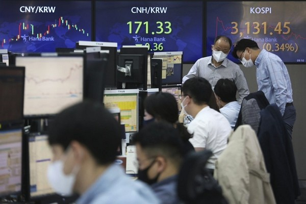 Currency traders wearing face masks work at the foreign exchange dealing room of the KEB Hana Bank headquarters in Seoul, South Korea.