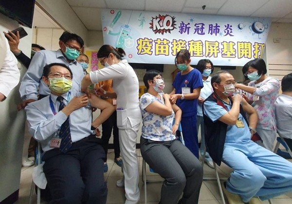 Medical workers receiving AstraZeneca vaccine at Pingtung Christian Hospital.