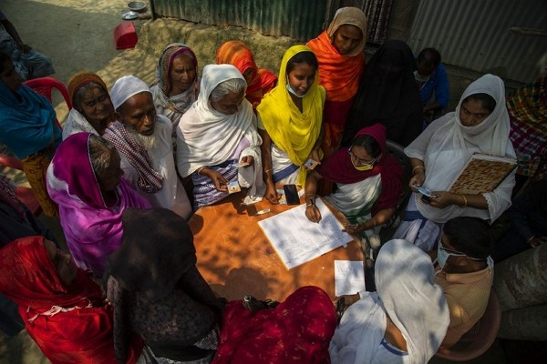 Elderly women wait to register for a COVID-19 vaccine in Bahakajari village in an interior part of Indian northeastern state of Assam, India.
