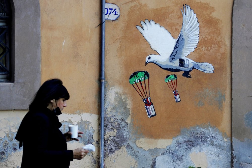 Mural in Rome featuring vaccines.