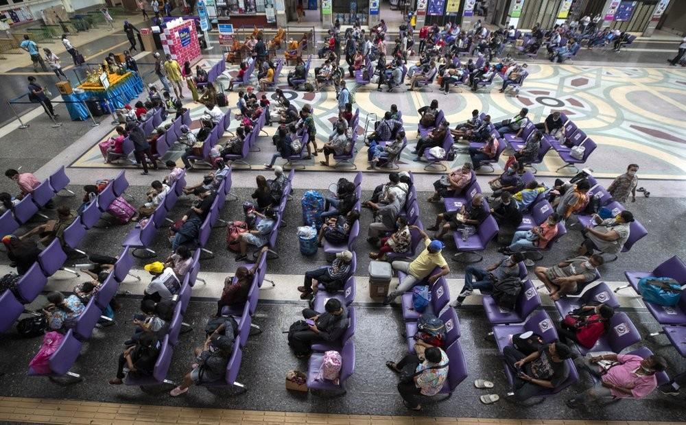 Passengers at Bangkok's main railway station waiting for trains at the start of the Songkran New Year holiday