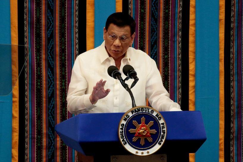 Philippine President Rodrigo Duterte gestures during his fourth State of the Nation address at the Philippine Congress in Quezon City, Metro Manila, P...