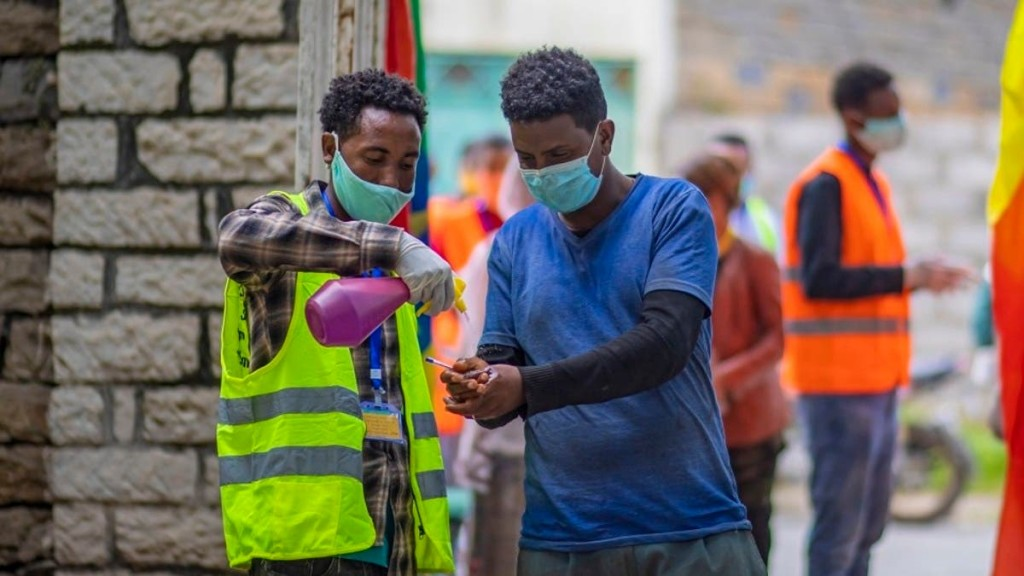 A man sanitizes his hands to curb the spread of the coronavirus in Ethiopia.