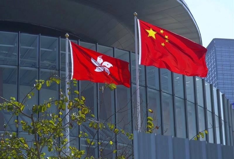 Chinese national flag (right) andHong Kong flag flutter atLegislative Council in Hong Kong on April 13, 2021.