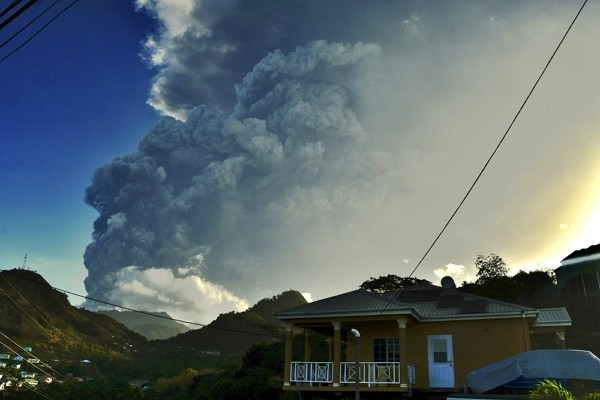 Ash rises into the air as La Soufriere volcano erupts on the eastern Caribbean island of St. Vincent.