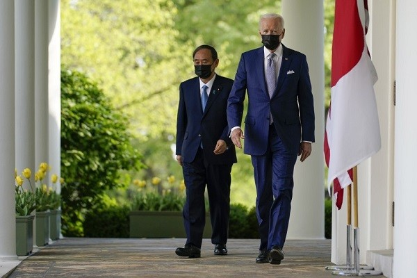 President Biden, Japanese Prime Minister Suga walk to White House Rose Garden for news conference after meeting for hours Friday.