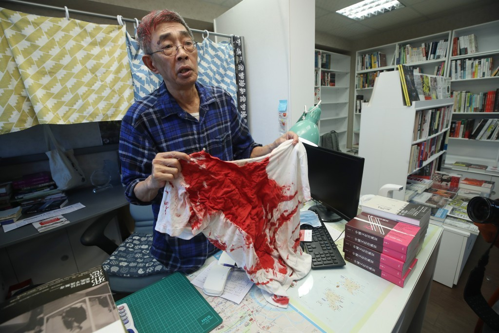 Lam Wing-kee showing T-shirt he wore duringApril 21, 2020, attack.