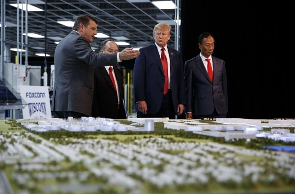Former U.S. President Donald Trump takes tour of Foxconn with Foxconn chairman Terry Gou (right) in Mt. Pleasant, Wisconsin.