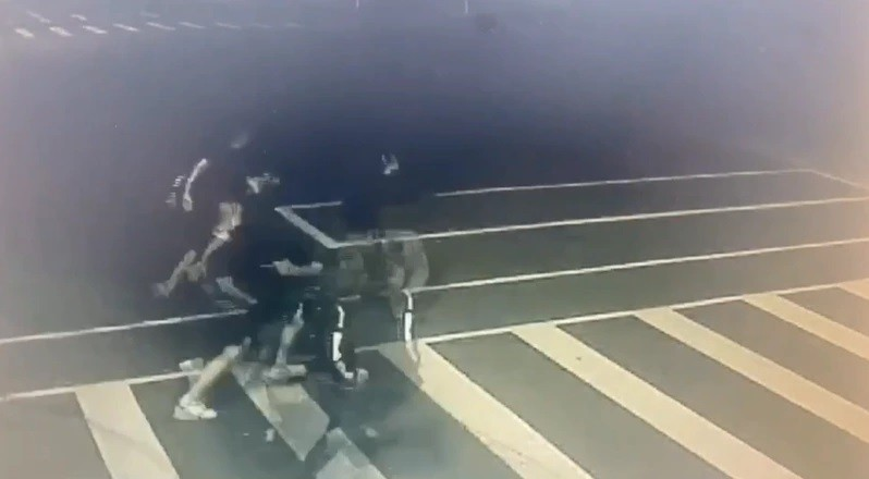 Men in black apologize for chasing cop into Taipei police station