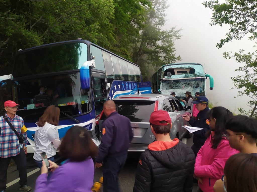 11 people were injured when two buses and an SUV collided on a Nantou County road Saturday
