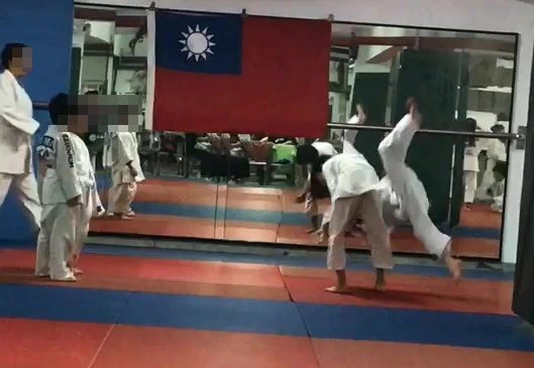 Huang is thrown as Ho steps into frame (left). (Facebook, Huang family photo)
