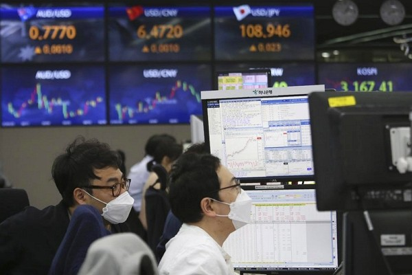 Currency traders watch monitors at the foreign exchange dealing room of the KEB Hana Bank headquarters in Seoul, South Korea.