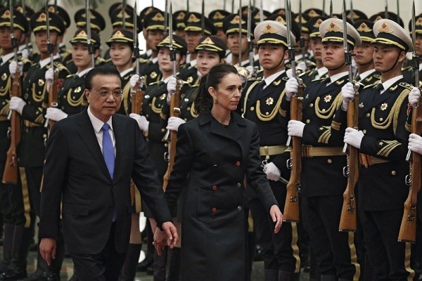 New Zealand Prime Minister Jacinda Ardern and Chinese Premier Li Keqiang review an honor guard during a welcome ceremony at the Great Hall of the Peop...
