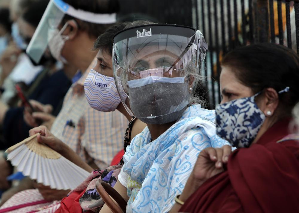 Indians waiting for coronavirus vaccination in Mumbai.