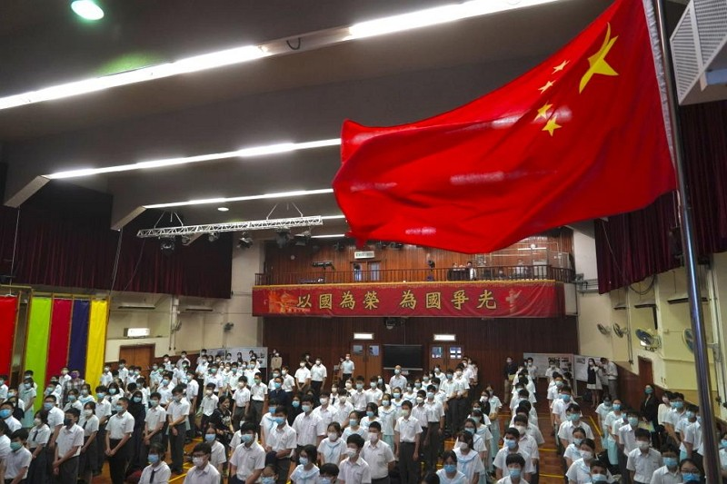 Students attend a flag raising ceremony during the National Security Education Day in Hong Kong, Thursday, April 15, 2021.