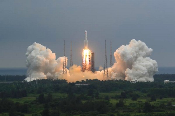 A Long March 5B rocket carrying a module for a Chinese space station lifts off from the Wenchang Spacecraft Launch Site in Wenchang in southern China&...