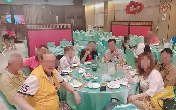 Former president (front, left) taking part in Lions Club event on May 6. (Photo from reader)