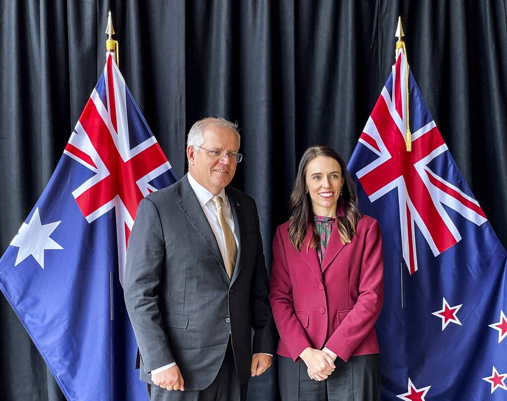 Australian Prime Minister Scott Morrison, left, poses for a photo with New Zealand Prime Minister Jacinda Ardern prior to talks in Queenstown, New Zea...
