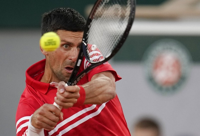 Serbia's Novak Djokovic plays a return to United States's Tennys Sandgren during their first round match on day three of the French Open, June...