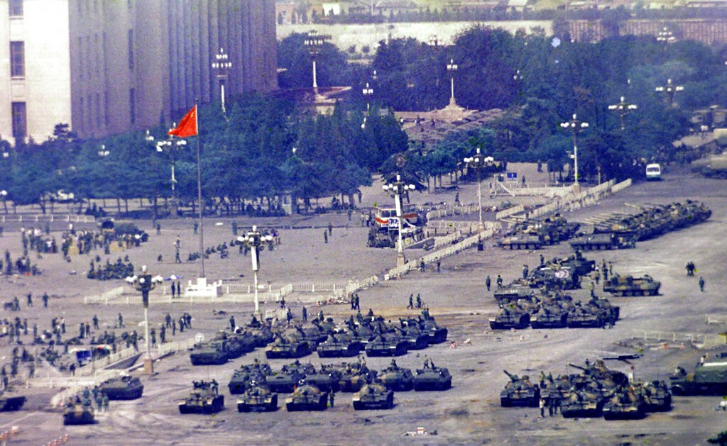 In this June 5, 1989, file photo, Chinese troops and tanks gather in Beijing, one day after the military crackdown that ended a seven week pro-democra...